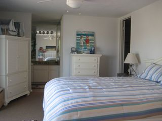Oceanside condo photo - Master Bedroom with Cal King bed and cottage-style furnishing. 36' flat screen