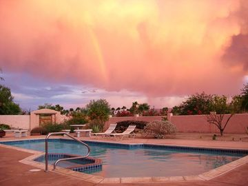 Summer Monsoon Rain with Forming Rainbow.