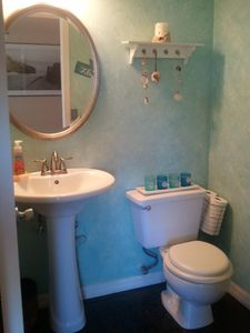 Tranquil Beach-themed Half Bath is conveniently located upstairs off Great Room.