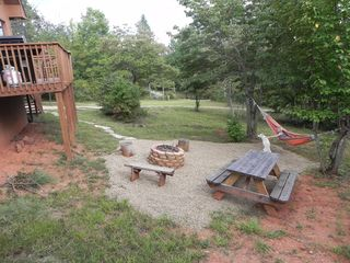 Helen cabin photo - Hammock, picknick table, firepit and seating for roasting those S'mores.