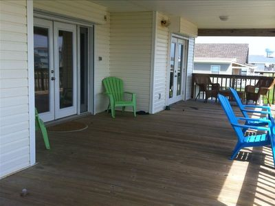 The large covered deck is perfect for relaxing and listening to the ocean