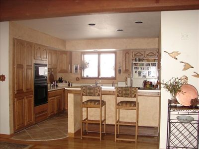 A fully equipped kitchen looks out at Tenderfoot Mountain & occasional wildlife.