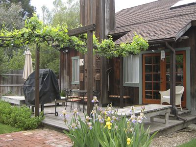 Relax on the redwood deck, bar-b-que, grape arbor