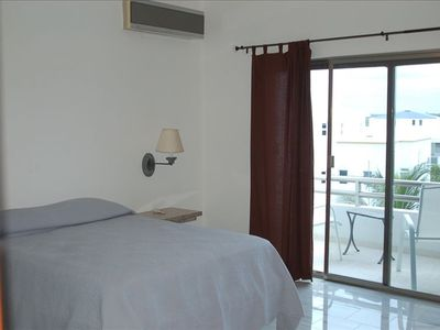 Second bedroom & balcony overlooking village. There is also private full bath.
