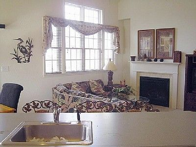 "Great room w/ L shaped couch, fireplace & 37"" HD/TV w/DVR and wireless internet."