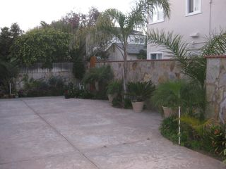 Ocean Beach house photo - Private, Tropical concrete patio area on lower level.