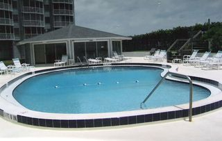Satellite Beach condo photo - Enjoy heated pool or ocean. The choice is yours.