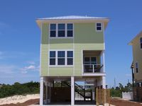Brand new construction! 3 bedroom 2.5 bath just steps from the beach!