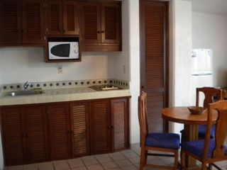 Cancun condo photo - Your fully equipped kitchen, large fridge, & dining area in penthouse studio!