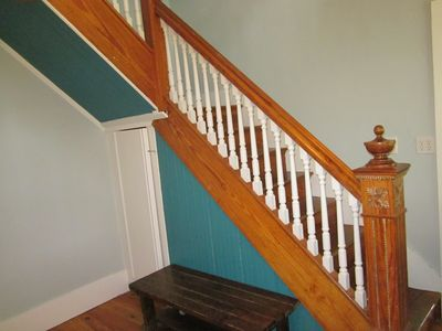 Old staircase leading to the second level and bedrooms.