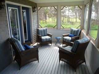 Miminegash cottage photo - Screened in porch offers comfortable lounging area