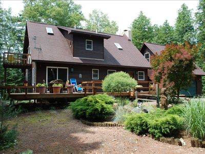 Large deck overlooking beautiful landscaped/wooded setting.