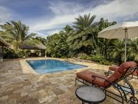 Tropical Haven with Saltwater Pool, Pet friendly, VIP Beach access with chairs