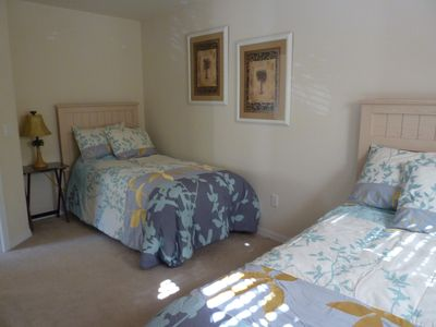 2 twin beds with 32 in. flat screen TV