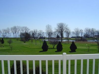 View from balcony off Master Bedroom, overlooking the golf course and lake