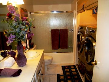 Guest bathroom with convenient utility access 2 baths in conod..