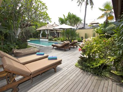 Large wooden deck with sun loungers