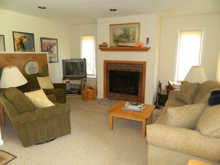 Carrabassett Valley condo photo - Living room area with wood burning fireplace