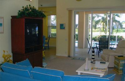 Living Room overlooks the lanai, pool/spa and 2nd fairway