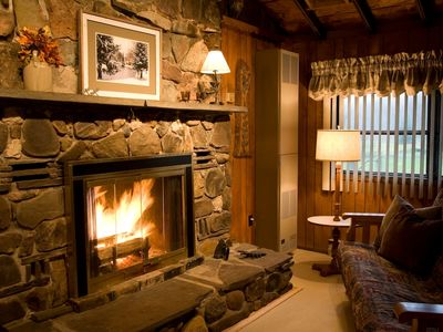 The huge fieldstone fireplace invites relaxation.