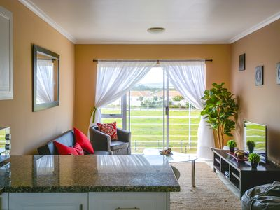 Relaxing condo w/ private balcony and parking space, one mile to the beach