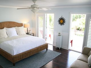 Crystal Beach house photo - Master Bedroom: Huge room, King bed, double French doors lead to outdoor balcony