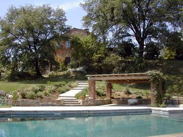 Lucignano farmhouse rental - View of pool up to house