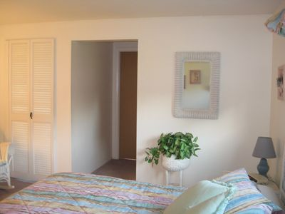 Master bedroom with king bed, door to lanai, and masterbath/large walkin closet.