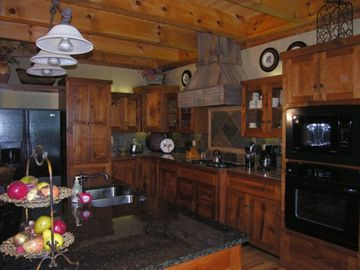 Kitchen, 5X8 ft granite surface island, cherry cabinets and stone backsplash