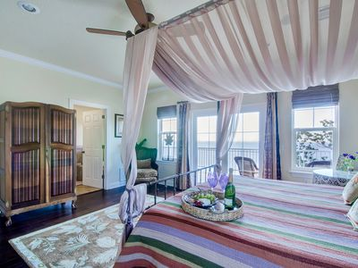 Relax in your romantic oasis - second floor master suite with balcony.