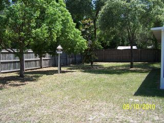 Spring Hill house photo - Fully Fenced Large Private Backyard with Shadded Trees