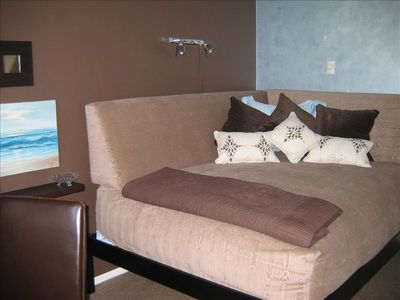 Guest room can be a den or remove bolsters to reveal a comfy queen bed. TV&DVD
