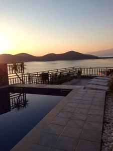 Elounda villa rental - Sun rise by the Pool across the bay of Mirabello