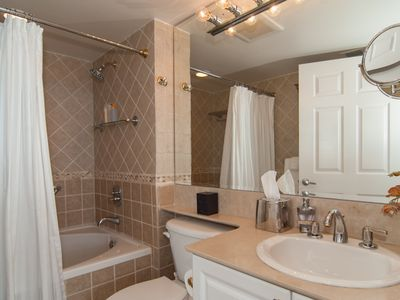 Bathroom adjoining master bedroom with Jacuzzi tub and shower