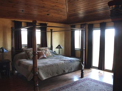 Master bedroom with king four poster bed and views of mountains