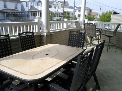 Oversized and covered deck with ample seating for 9 to enjoy the fresh air.