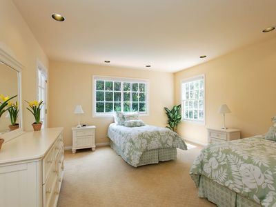 Third bedroom with two twin beds and large walk in closet