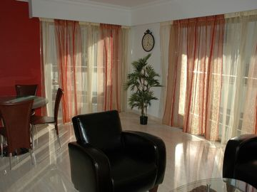 very bright living room with access to balcony (sea view) & terrace