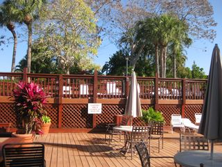 Naples condo photo - Sun Deck and Grills/Tables to eat at