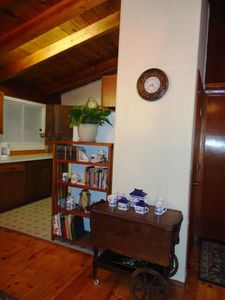 Book case and tea cart in the kitchen/dining room area.