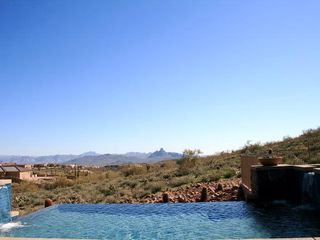 Fountain Hills house photo - Infinity Pool 'spilling' out to the desert. Red Rock in the distance.