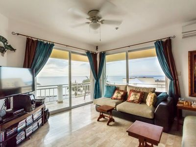 Living room has wrap around balcony with fantastic ocean views