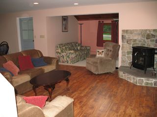 North Ferrisburg house photo - Living room with fireplace and wood floors