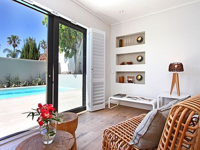 5 * Boutique Design Apartment with solar heated salt water pool in a fantastic location.