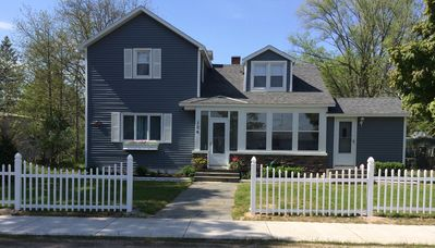 The front of the house with new sidewalk and decorative  fence --- June, 2014