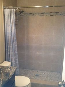 Master Bathroom with river rock shower floor