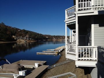Tulloch Lake condo rental - View of corner of condo, overlooking private dock and Lake Tulloch.