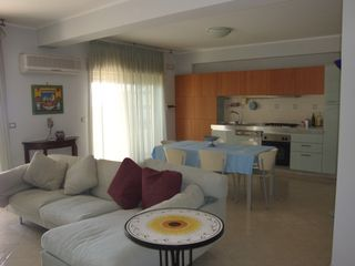 Taormina apartment photo - single space: sitting area, dining area, kitchen
