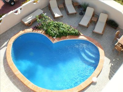 Heart shaped pool and sunning deck