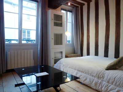 Apt. Descartes - Paris - Living area offers a comfortable bed for 2